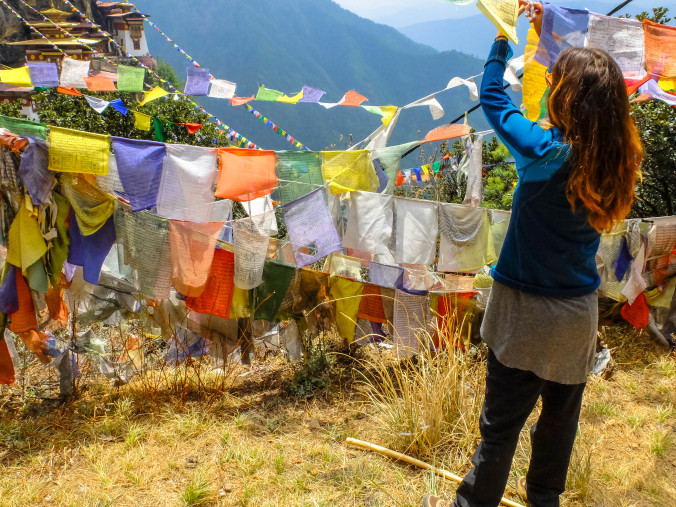 Hanging prayer flags in the wind