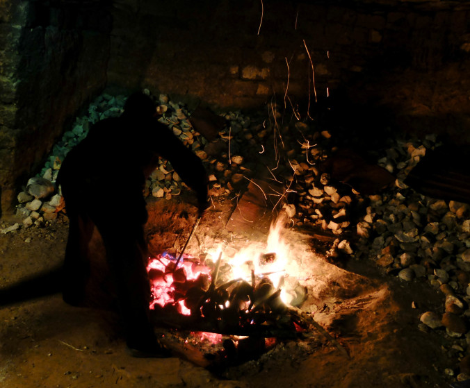 heating up the stones in the fire